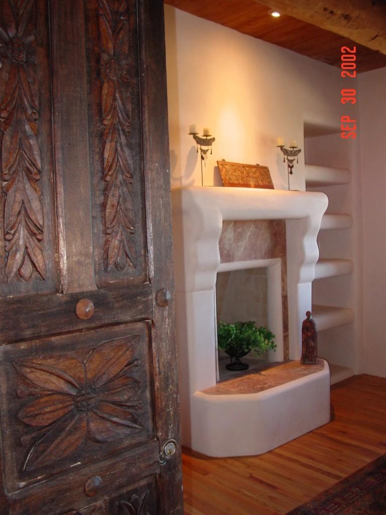 Antique doors lead to master bedroom fireplace.