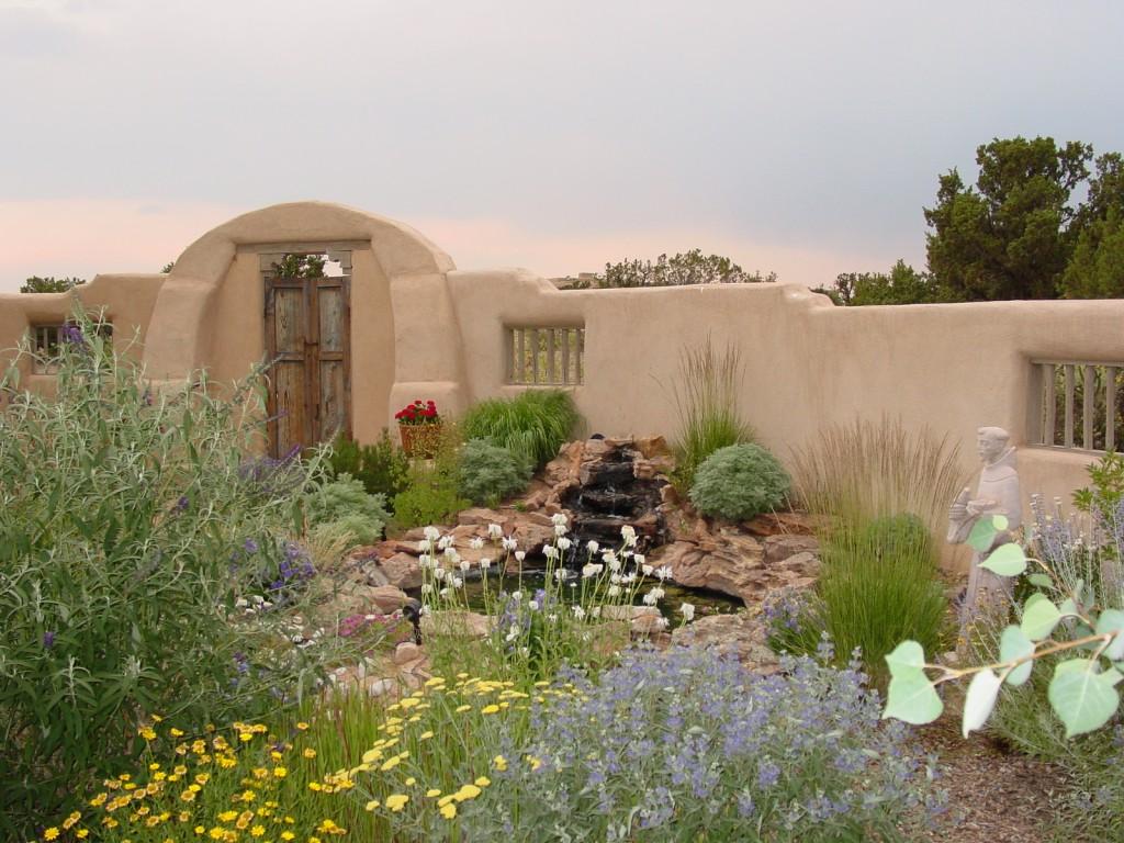 Adobe walled Santa Fe courtyard.