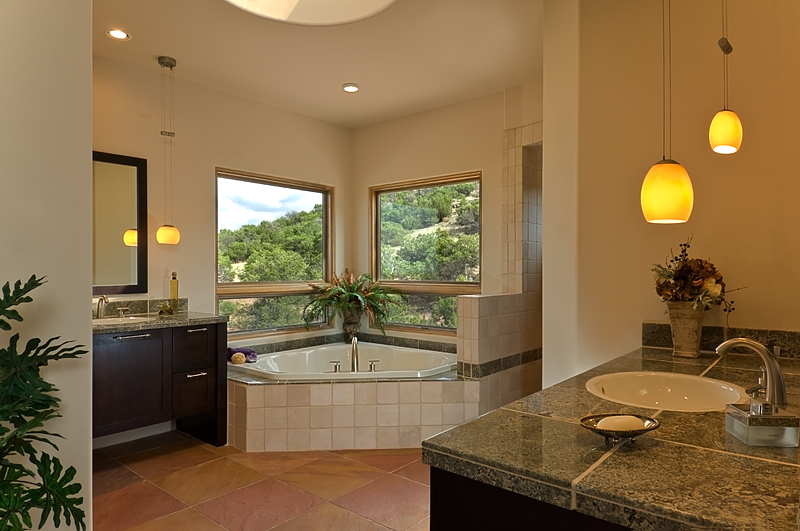 Contemporary master bath highlights views.
