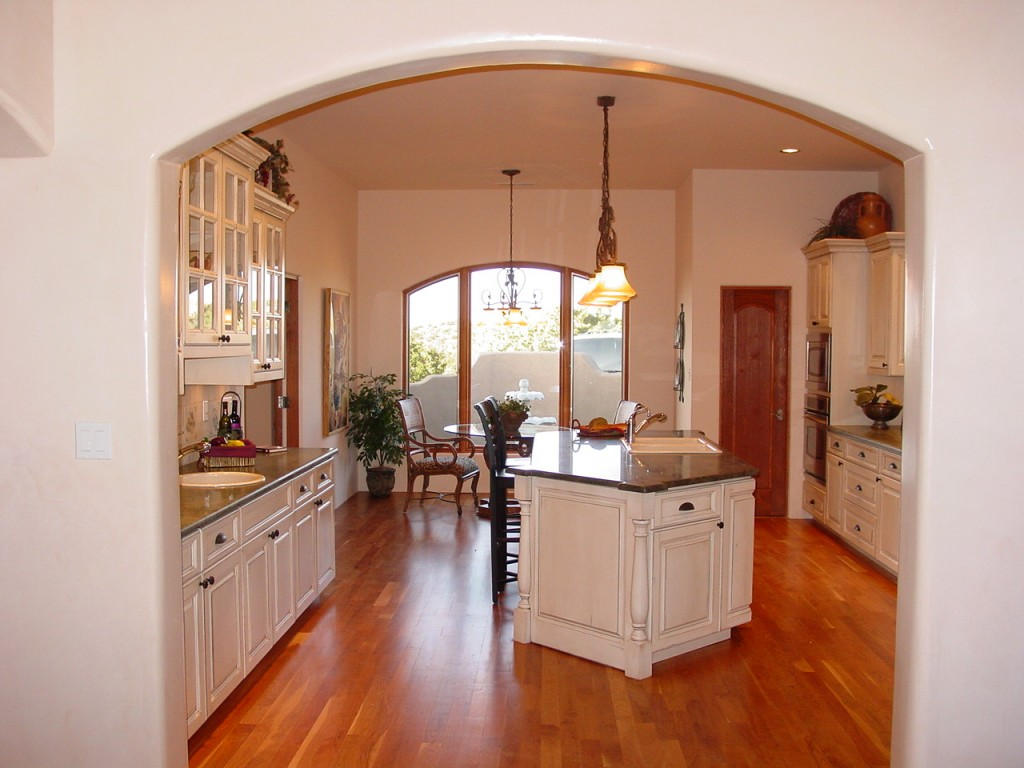 Beautiful kitchen with cherry floors.